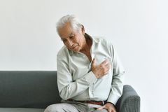 Heart attack disease problem in old man, Elderly asian man with hand on chest gesture.