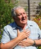 Heart attack, elderly man closeup.