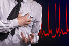 Heart Attack. Man grabs his heart: He has a heart attack Stock Image