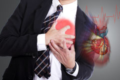 Heart Attack. Use hand grabbing a chest with white background Stock Image