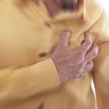 Heart Attack ,Use hand grabbing a chest Royalty Free Stock Images
