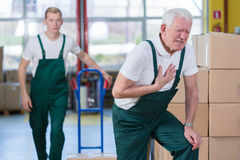 Heart attack in workplace. Senior employee having heart attack in workplace Royalty Free Stock Images