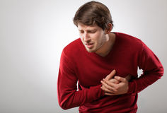 Heart attack. Young athletic man has a sudden heart attack Stock Images