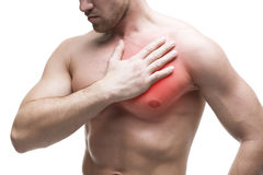 Heart attack. Young muscular man with chest pain isolated on white background. With red dot royalty free stock images