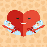 Heart with babies on hands. Stock Photos