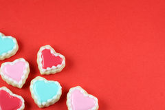 Heart Background. Heart cookies on a red background royalty free stock image