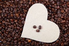 Heart on the background of coffee beans Royalty Free Stock Photos