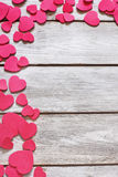 Heart background. Copyspace old wooden background with messed red hearts Royalty Free Stock Images