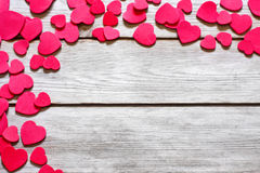 Heart background. Copyspace old wooden background with messed red hearts Stock Photo