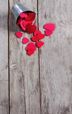 Heart background. Copyspace old wooden background with small steel bucket an red hearts Stock Images