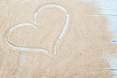 Heart background drawn on the sand of a beach, love background valentine day with happy holiday, or wedding vintage wallpaper, wom. An or mother day concept Stock Images