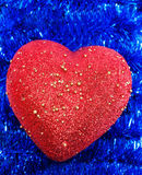 Heart on background tinsel Stock Photo