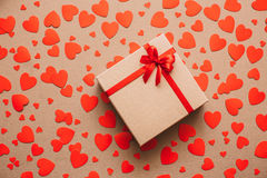 Heart background. Valentines day. Abstract paper hearts and gift box with red ribbon. Stock Photos
