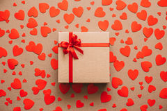 Heart background. Valentines day. Abstract paper hearts and gift box with red ribbon. Royalty Free Stock Photography