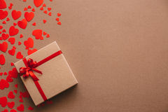 Heart background. Valentines day. Abstract paper hearts and gift box with red ribbon. Royalty Free Stock Photos