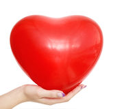 Heart balloon in hand. Heart ballon in hand isolated over white background Royalty Free Stock Images