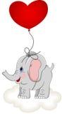 Heart balloon lifting up baby elephant Stock Image