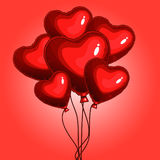 Heart balloons. Balloons red hearts on strings Stock Image