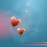 Heart balloons in the sky Royalty Free Stock Image