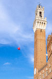 Heart baloon in front of Siena bell tower, Siena, Tuscany, Italy. Heart baloon in the center of Siena, near bell tower Piazza del campo Stock Photography