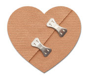 Heart Bandage. With Metal Clips Isolated on a White Background Stock Images