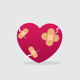 Heart Bandages. Cracked heart with multiple bandages Royalty Free Stock Images