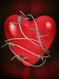 Heart in Barbed Wire on Red 2 Royalty Free Stock Photos