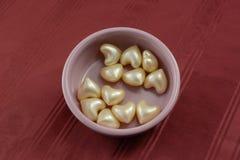 Heart Bath oil beads Stock Photography