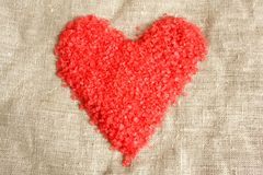 Heart from bath salt. On a cloth background Royalty Free Stock Images