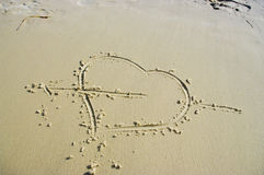 Heart on beach. Drawn heart on sand beach Stock Photos