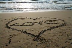 Heart beach. Heart written on the beach to show the love Stock Photos
