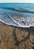 Heart on beach. A heart drawn in sand on a beach Stock Image
