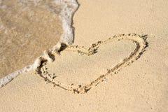 Heart on beach Stock Image