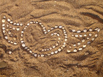Heart on the beach. A heart shape on the beach, made of white stones Royalty Free Stock Photo