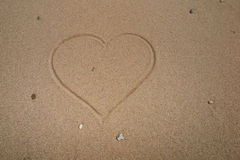 Heart on the beach drawing on the sand Royalty Free Stock Image