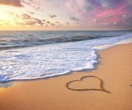 Heart on beach. stock images