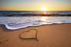 Heart on beach Stock Images