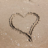Heart on beach. Romantic composition. Royalty Free Stock Image