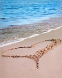 The heart on the beach sand Stock Images