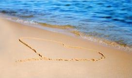The heart on beach sand. The heart drawen on beach sand Royalty Free Stock Photo