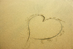 Heart on beach sand Royalty Free Stock Photos