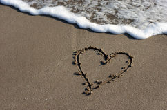 Heart on beach sand Stock Photos