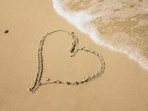 Heart on beach. Heart shape drawn in sand on a beach Stock Image