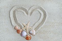 Heart on the beach with shell Royalty Free Stock Image