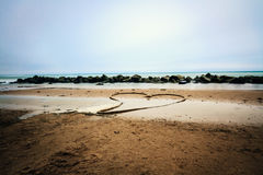 Heart on the beach. Turned a rope into a heart on the beach Royalty Free Stock Photo