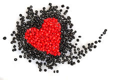 Heart Bead. Is scattered beads in the shape of heart on white fur Stock Photos