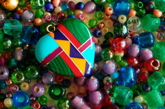 Heart and beads. Heart and colorful beads Royalty Free Stock Photos