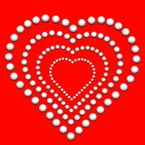 Heart from beads Stock Photos