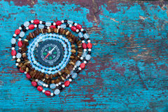 Heart of beads with compass Royalty Free Stock Image
