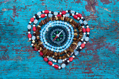 Heart of beads with compass Royalty Free Stock Photo